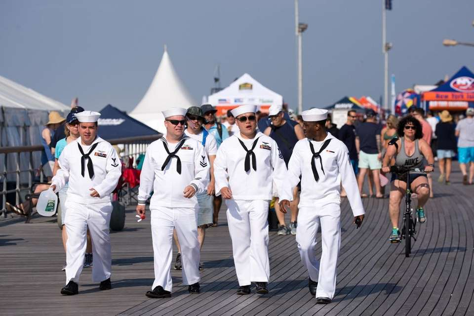 Members of the NAVY walk along the boardwalk