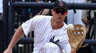Yankees first baseman Greg Bird fields the ball