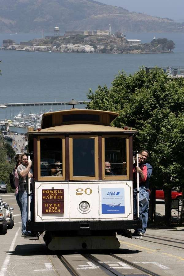 A cable car full of people makes its