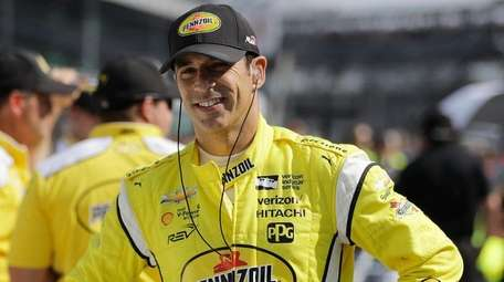 Helio Castroneves waits during qualifications for the Indianapolis