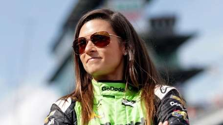 Danica Patrick waits during qualifications for the