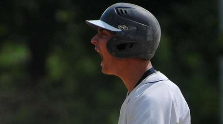 Jake Lazzaro #20 of Oceanside reacts after connecting