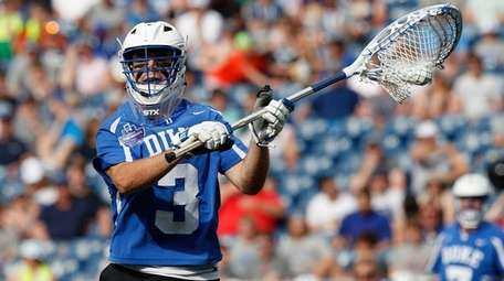 Duke goalie Danny Fowler looks to pass during