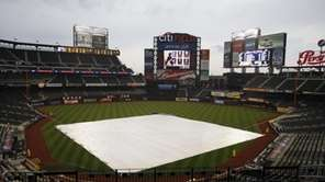 The tarp is on the field as rain