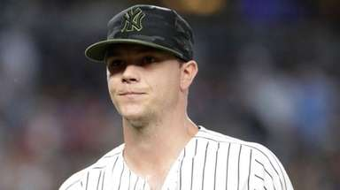 Yankees pitcher Sonny Gray walks off the field