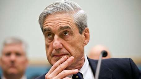 FBI Director Robert Mueller listens as he testifies