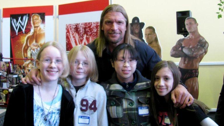 WWE superstar wrestler Triple H with Kidsday reporters