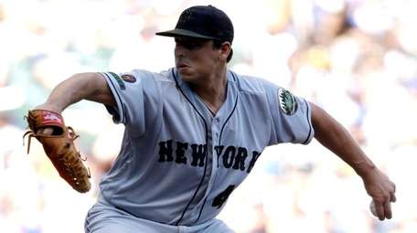 Mets starting pitcher Jason Vargas throws to the