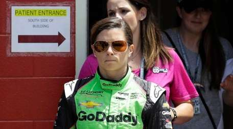 Danica Patrick leaves the infield hospital after being