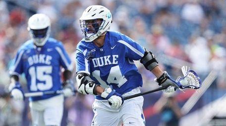 Justin Guterding #14 of Duke moves against Maryland