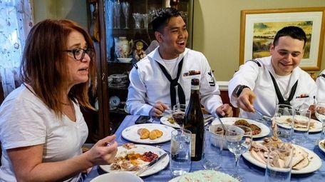 Abby Oshrain, with Navy sailors Bobby Louangrath and
