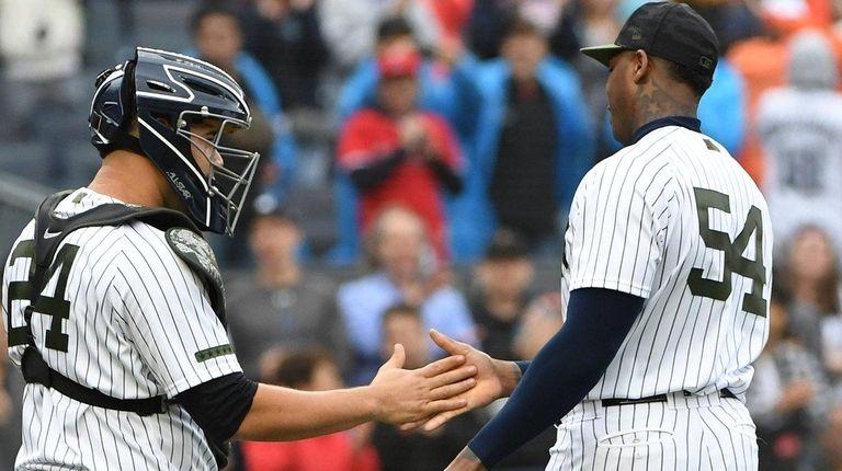 Yankees relief pitcher Aroldis Chapman and Yankees catcher
