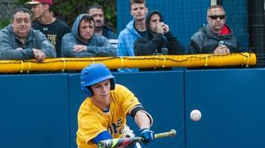 West Islip's Bobby DiCapua bunts during Game 1