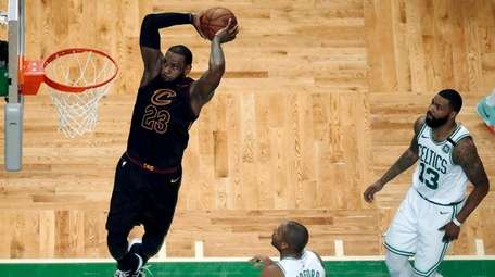 Cleveland Cavaliers forward LeBron James soars to dunk