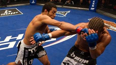 Jose Aldo, top, defended his featherweight title with