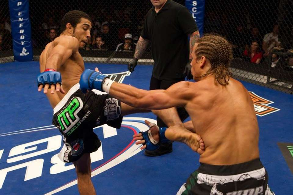 Jose Aldo, left, defended his featherweight title with