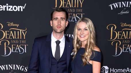 Matthew Lewis and Angela Jones attend Disney's
