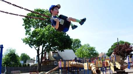 Harry Tully, 3, of Floral Park, plays at