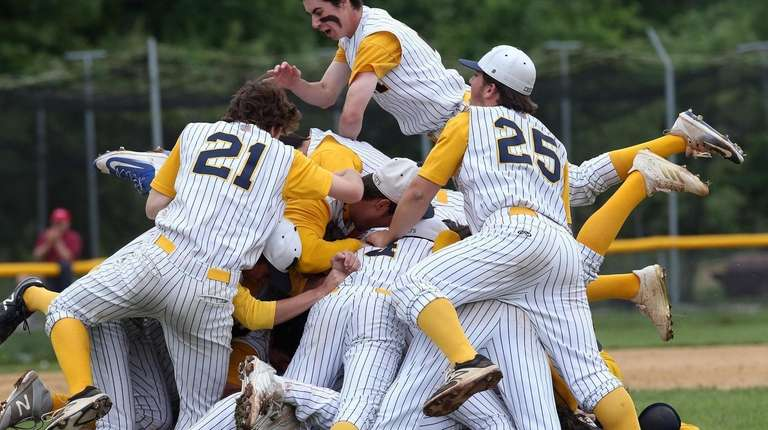 Massapequa celebrates winning the Nassau Class AA baseball