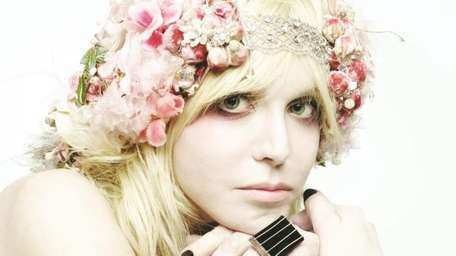 Singer Courtney Love and her band Hole release