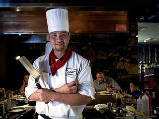 Hibachi Chef Kevin Nguyen smiles for the camera