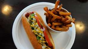 "The ""Chicago Dog"" is covered with onions, relish,"