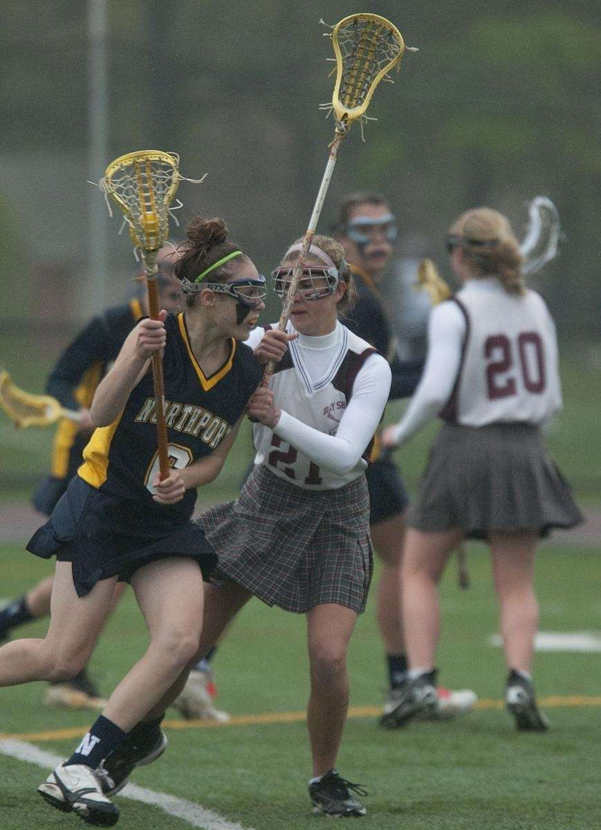 Northport's Paige Bonomi, left, looks to take a
