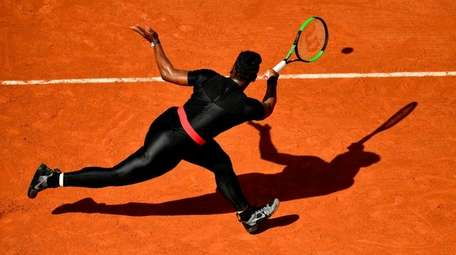 Serena Williams plays a backhand return to Kristyna