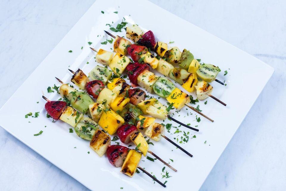 A platter of Grilled Fruit Kebabs, skewers of