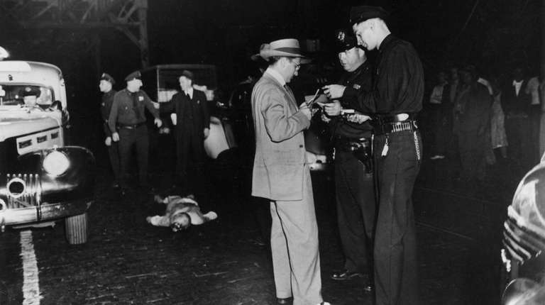 Weegee's photo of an accident victim surrounded by