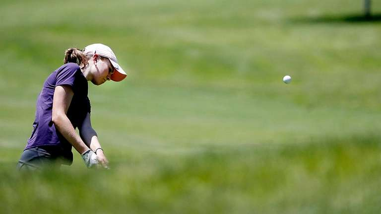 Sayville's Ceili Howland chips onto the green on