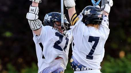 Massapequa's Timmy Ley and Garrett Gibbons celebrate a