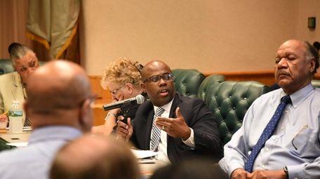 Jamal Scott, center, Uniondale assistant superintendent for business
