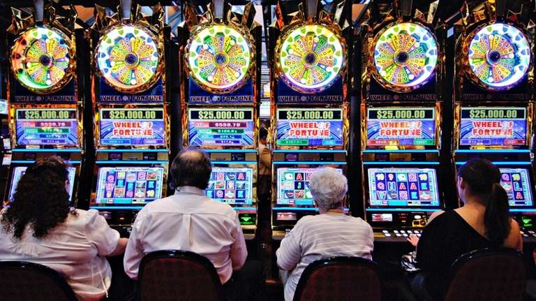 In this file photo, patrons play slot machines