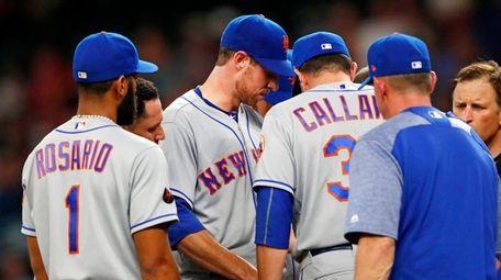 Mets pitcher Steven Matz talks with Mickey Callaway