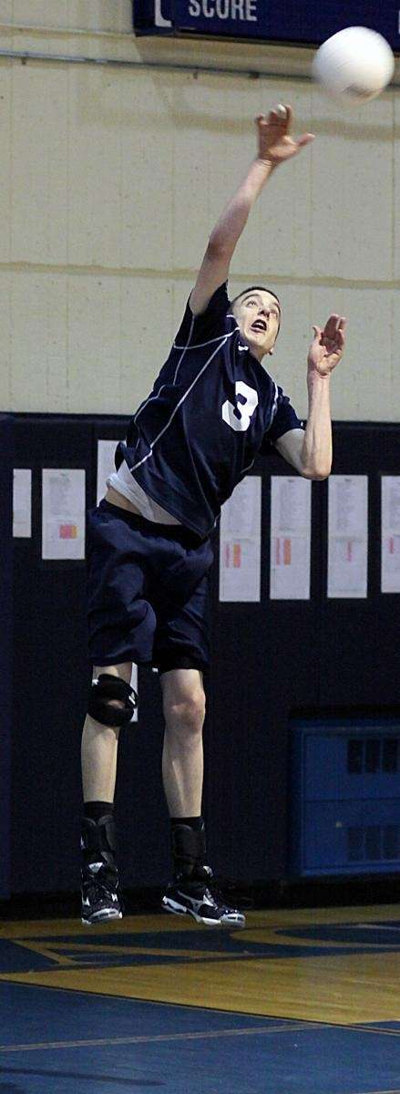 Massapequa's Christian Smith with the serve. (April 27,