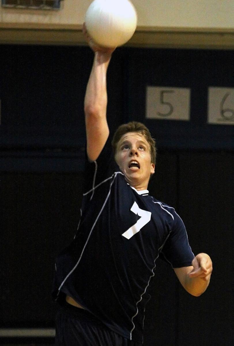 Massapequa's Brian Smith with the serve. (April 27,