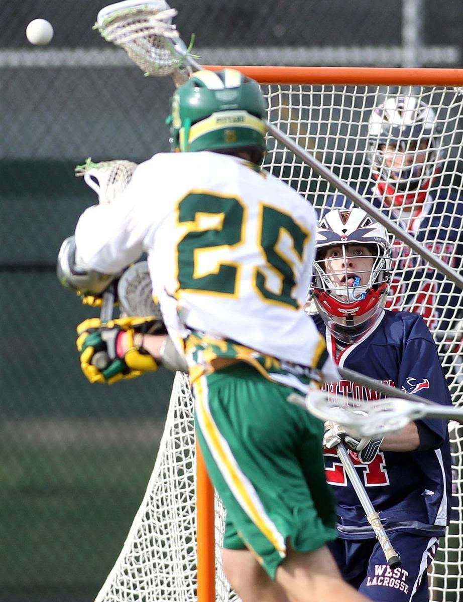 Smithtown goalie Ryan Adler (24) waits for the