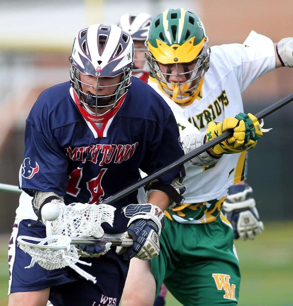 Ward Melville's James Cashin (7) knocks the ball