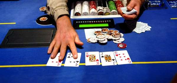 A dealer at the poker table. (Sept. 4,