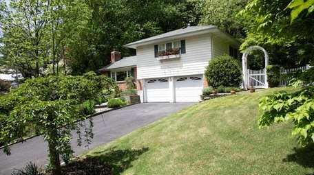 This four-bedroom Glen Cove split-level is listed for