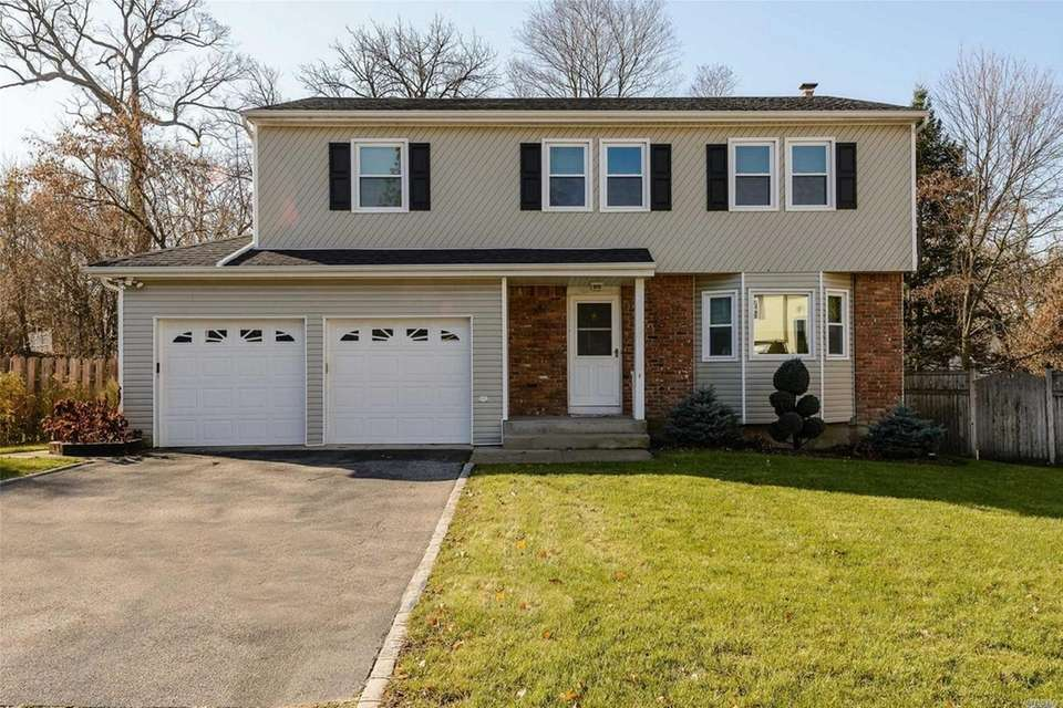 This Glen Cove Colonial includes four bedrooms and