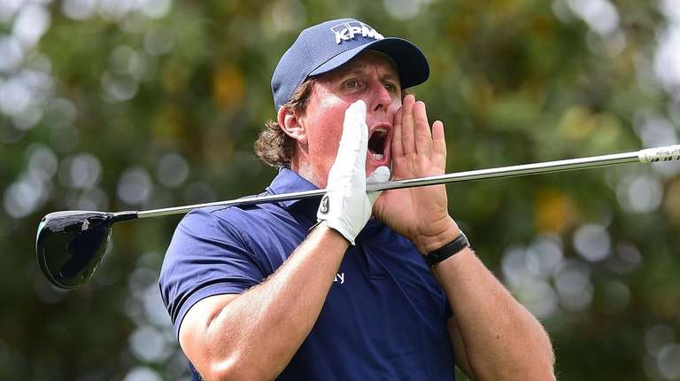 Phil Mickelson reacts following his tee shot