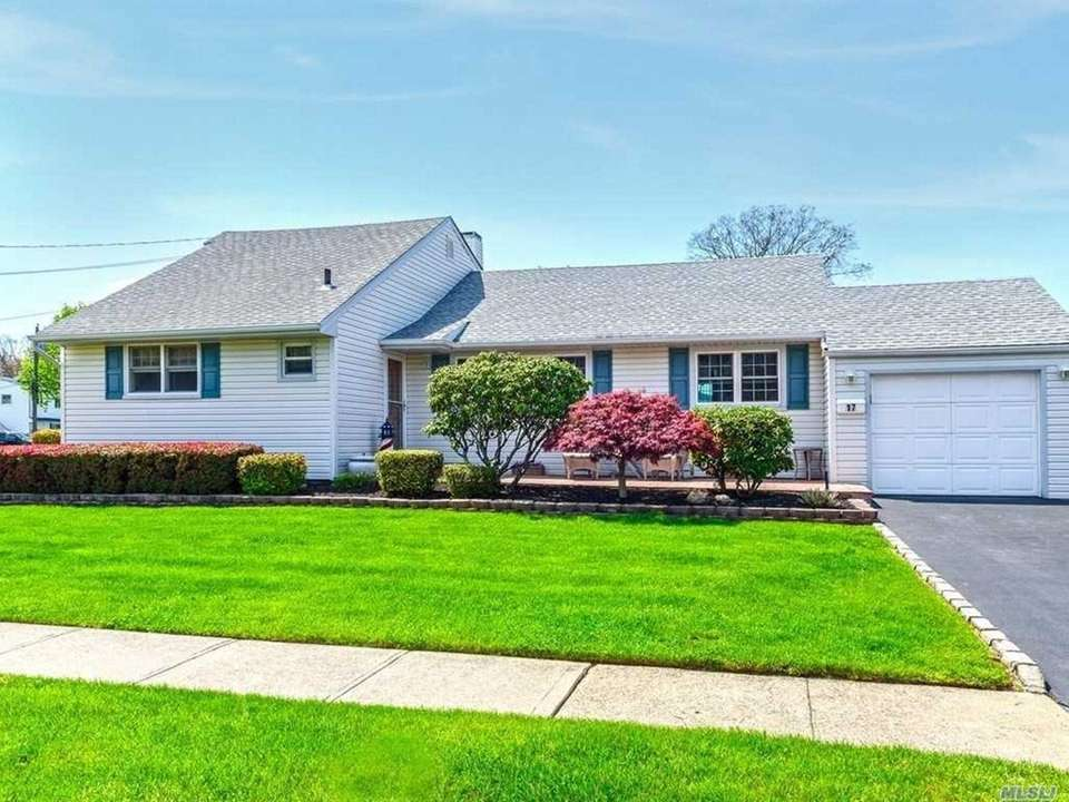 This North Babylon split-level includes four bedrooms and