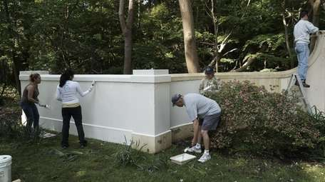Residents paint a wall in Head of the