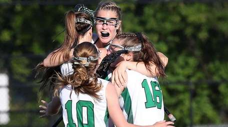 Carle Place's Abby Selhorn, center, celebrates with teammates