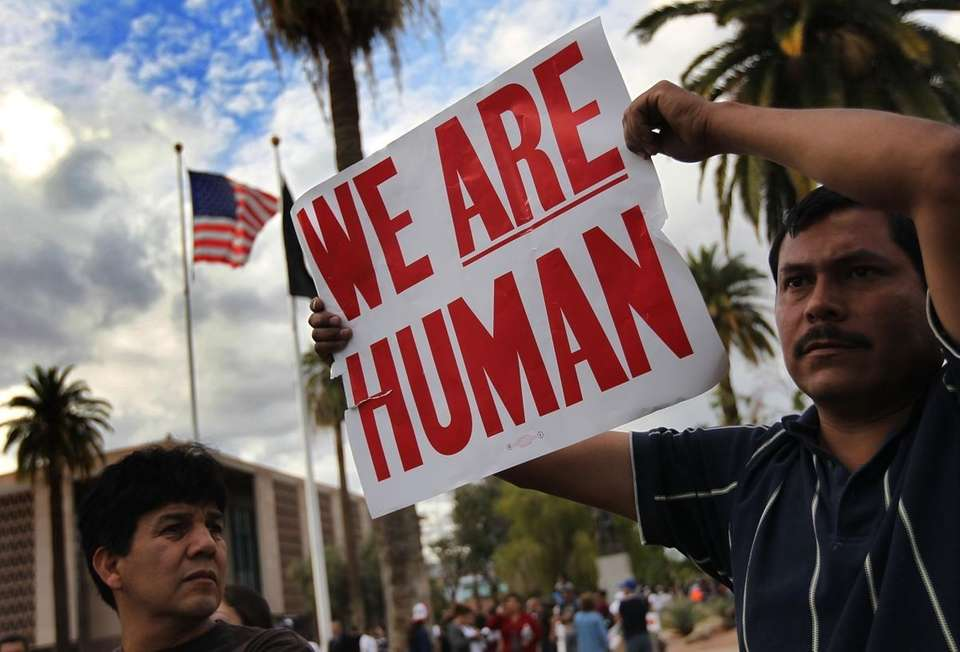 Demonstrators protest Arizona's new immigration law in Phoenix.