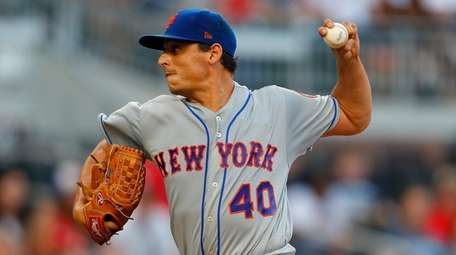 Mets' Jason Vargas delivers a pitch in the