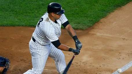 Yankees catcher Gary Sanchez connects on a two-run