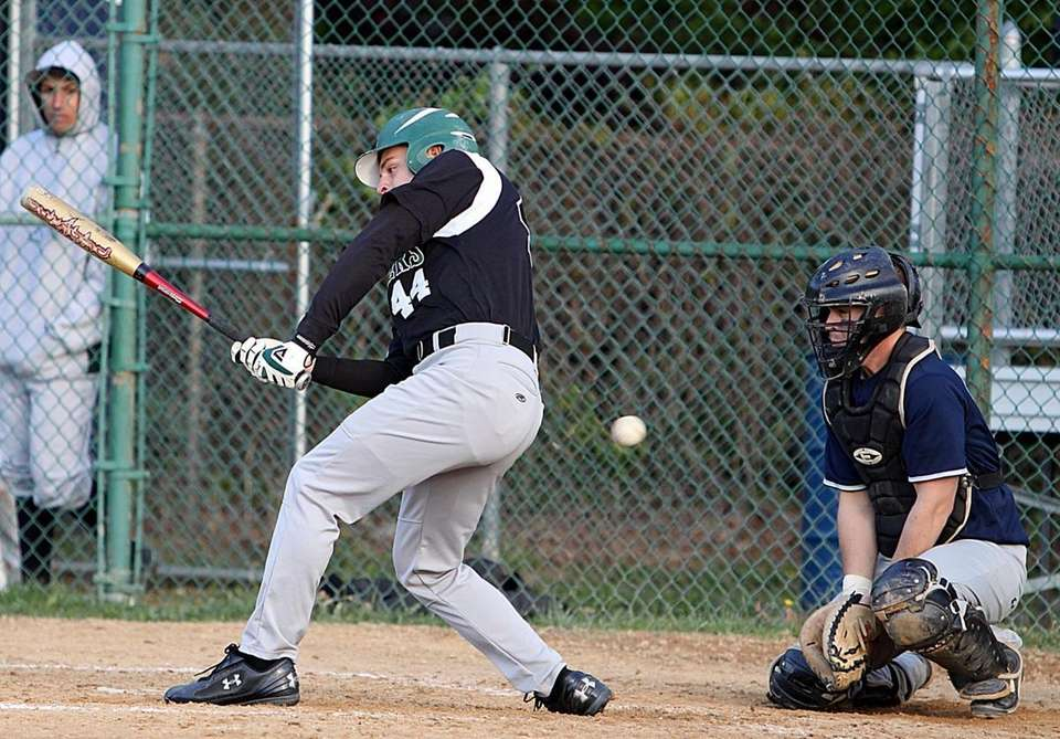 Farmingdale's Nick Colasurdo swings at strike three in
